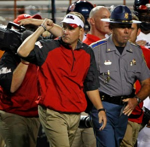 Ole Miss coach Hugh Freeze reaches out to Clemson OC Chad Morris.