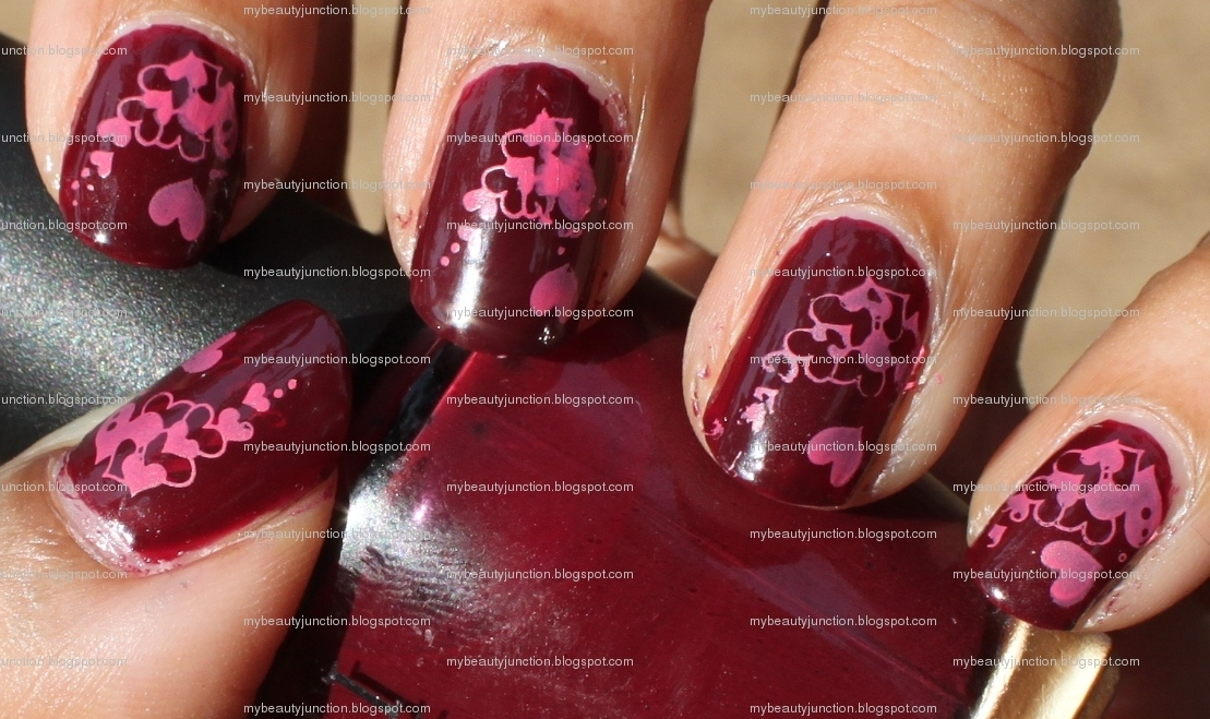 Manicure: O.P.I. Mrs O'Leary's BBQ nail polish with pink heart stamping nail art