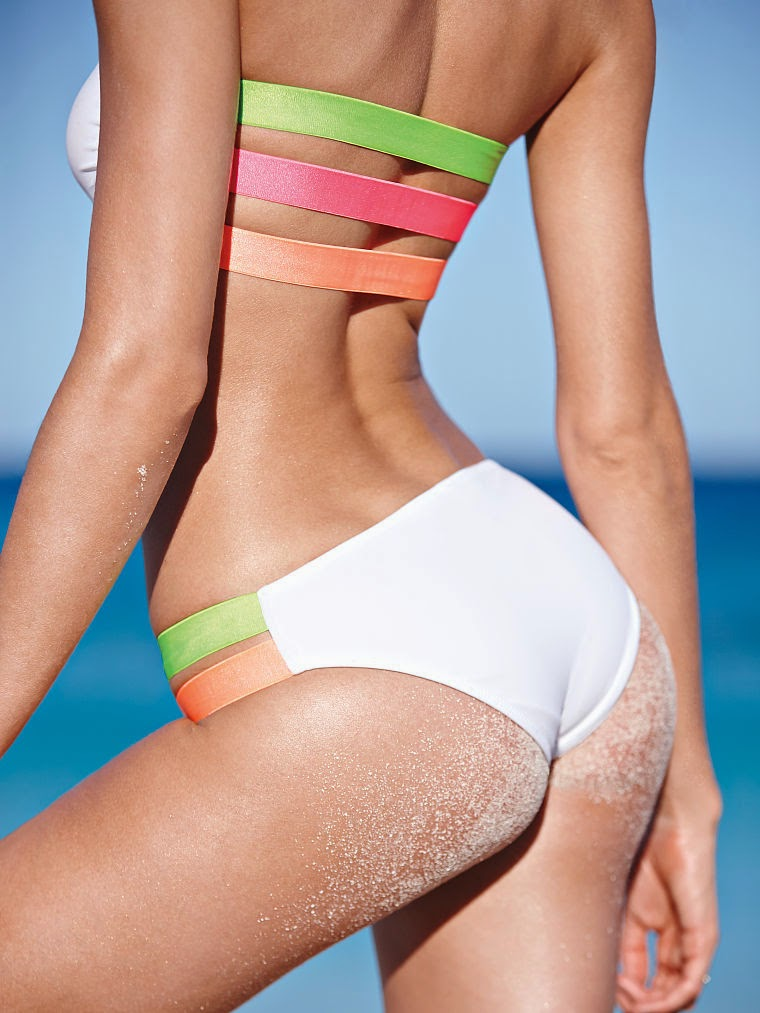 Candice Swanepoel in sexy swimwear looks from the Victoria's Secret April 2014 collection