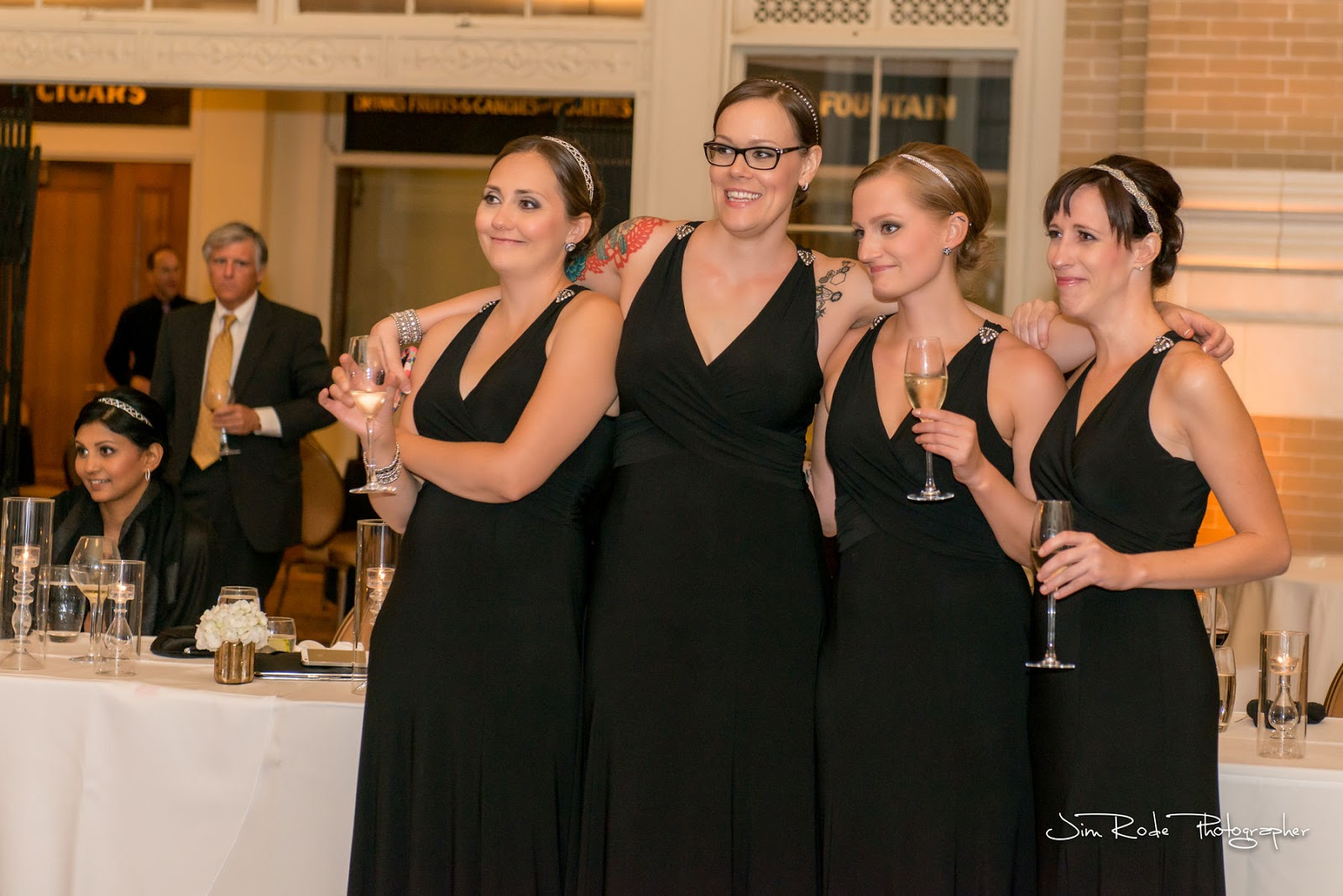 Bridesmaids enjoying every moment of toast at the Dallas wedding.