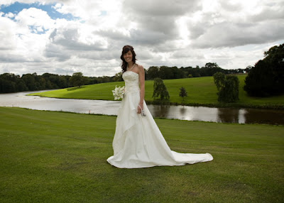 Bride by the lake at Wynyard Hall