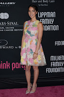 Olivia Munn posing on the pink carpet