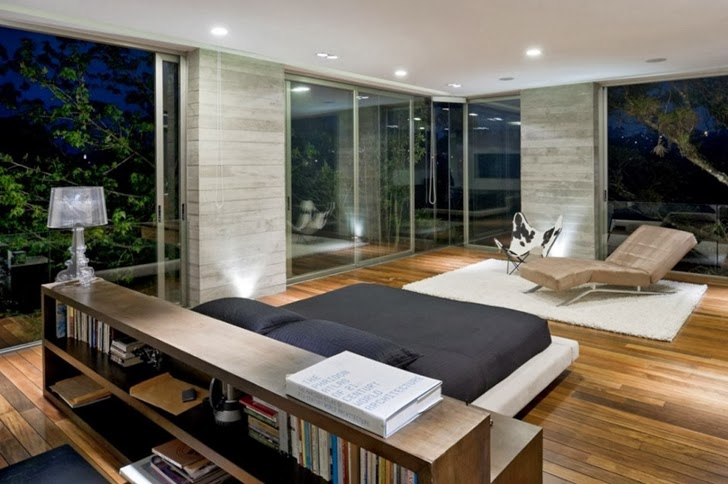 Bedroom at night in Modern dream home by Paz Arquitectura