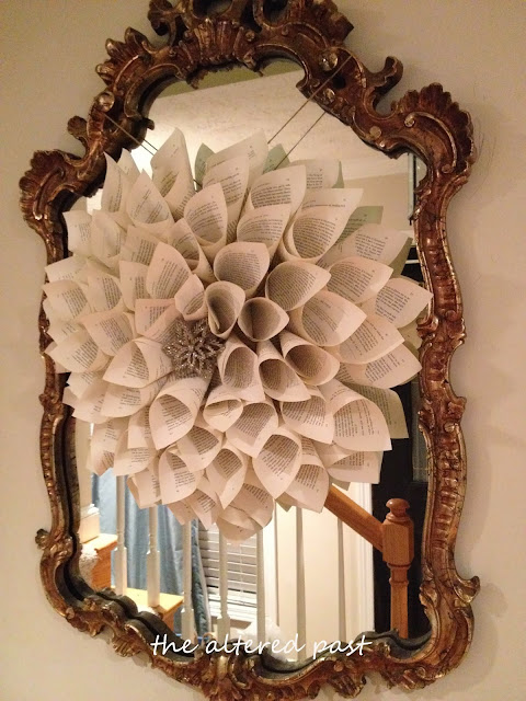 easy diy book page wreath hung on antique mirror