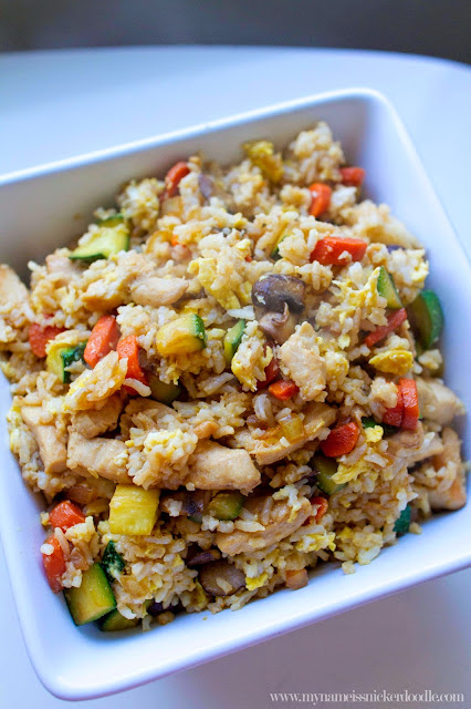 Super easy and delicious Chicken Fried Rice recipe.  It comes together in minutes and perfect for using leftover rice!  A great weeknight meal.  |  mynameissnickerdoodle.com