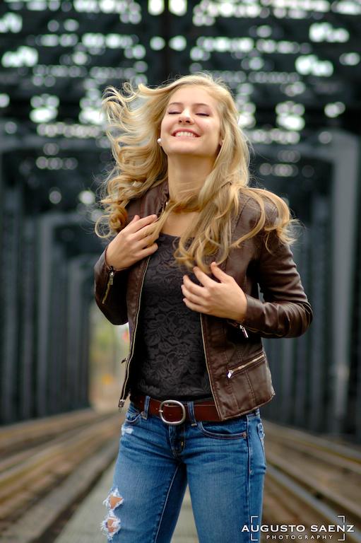 Blond Senior Girl by rail tracks with flying hair
