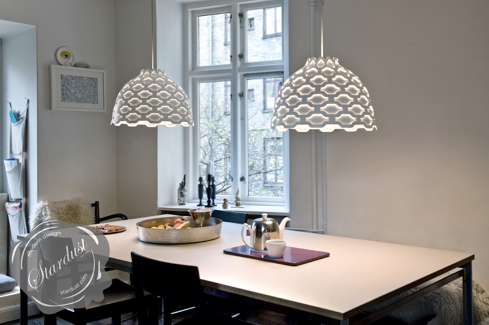 Lc shutters by louis poulsen for Dining table lighting ideas