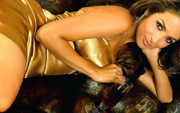 Malaika Arora Khan in tight golden color skirt showing her huge ass drinking wine on bed