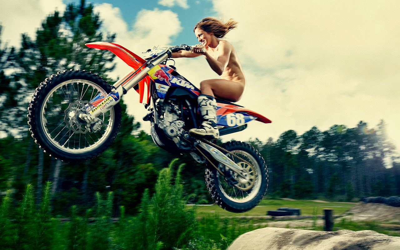 Naked girl on dirt bike