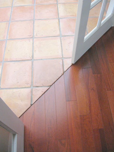 Brazilian cherry engineered wood floor and saltillo tile