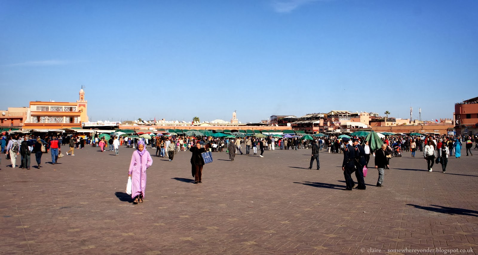 Locals walk through Djemaa El-Fna Marrakech