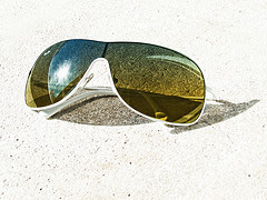 Sunglasses taking a sunbath by Andres Rueda via Flickr and a Creative Commons license
