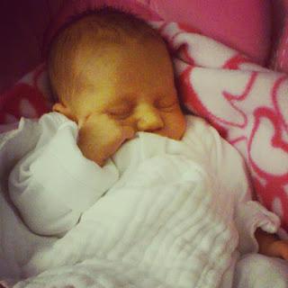 premature baby asleep with muslin