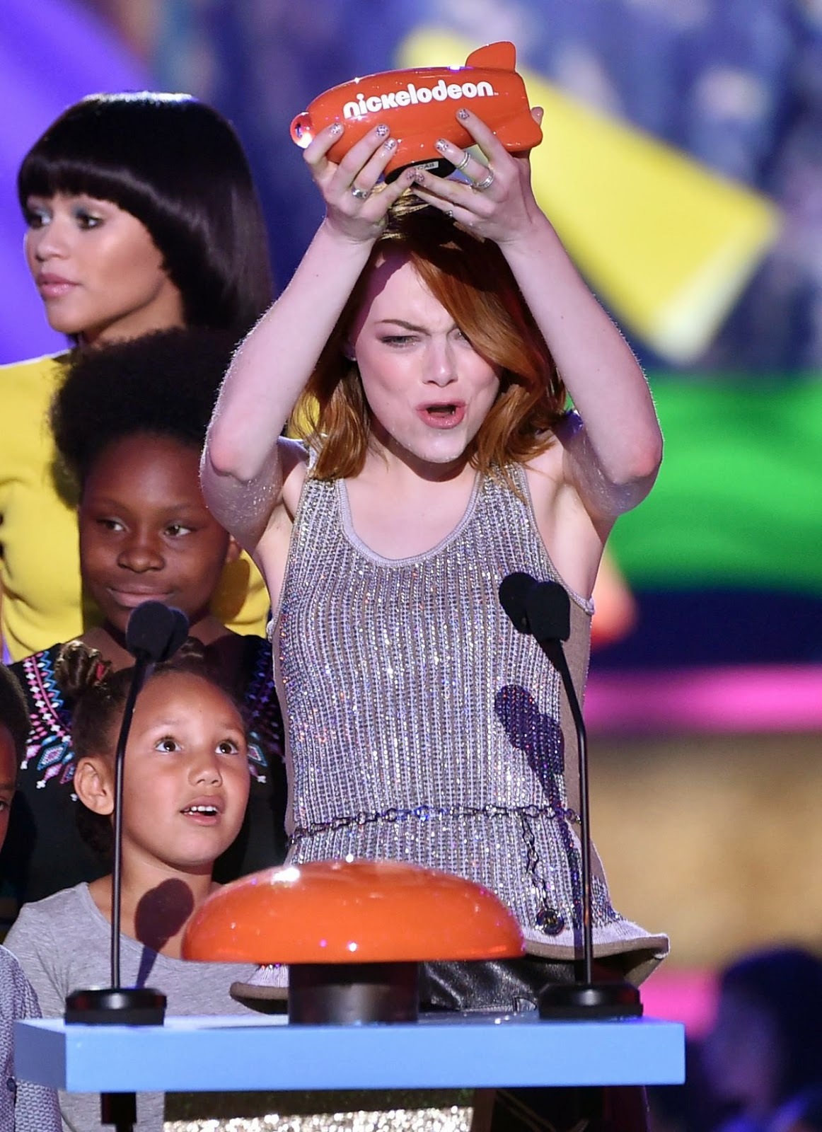 Emma Stone in a sequinned top and leather skirt at the 2015 Nickelodeon Kids' Choice Awards