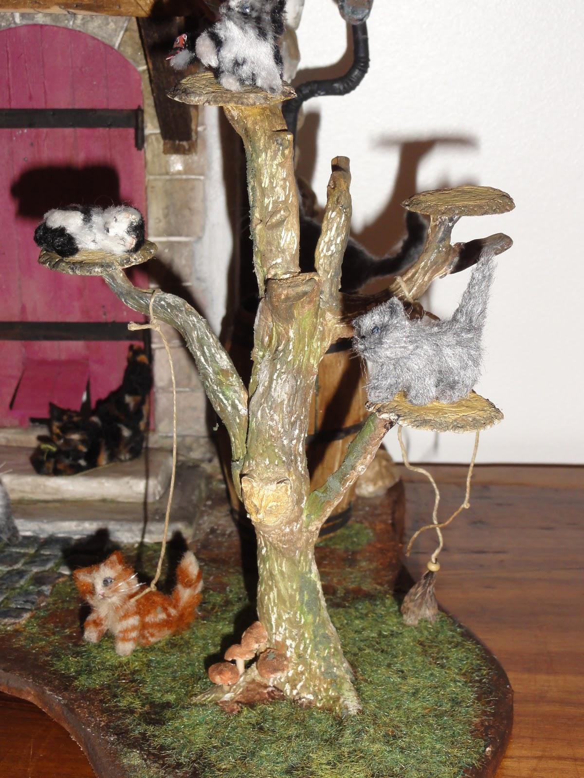 le monde cr atif de catherine le pr sentoir chats. Black Bedroom Furniture Sets. Home Design Ideas