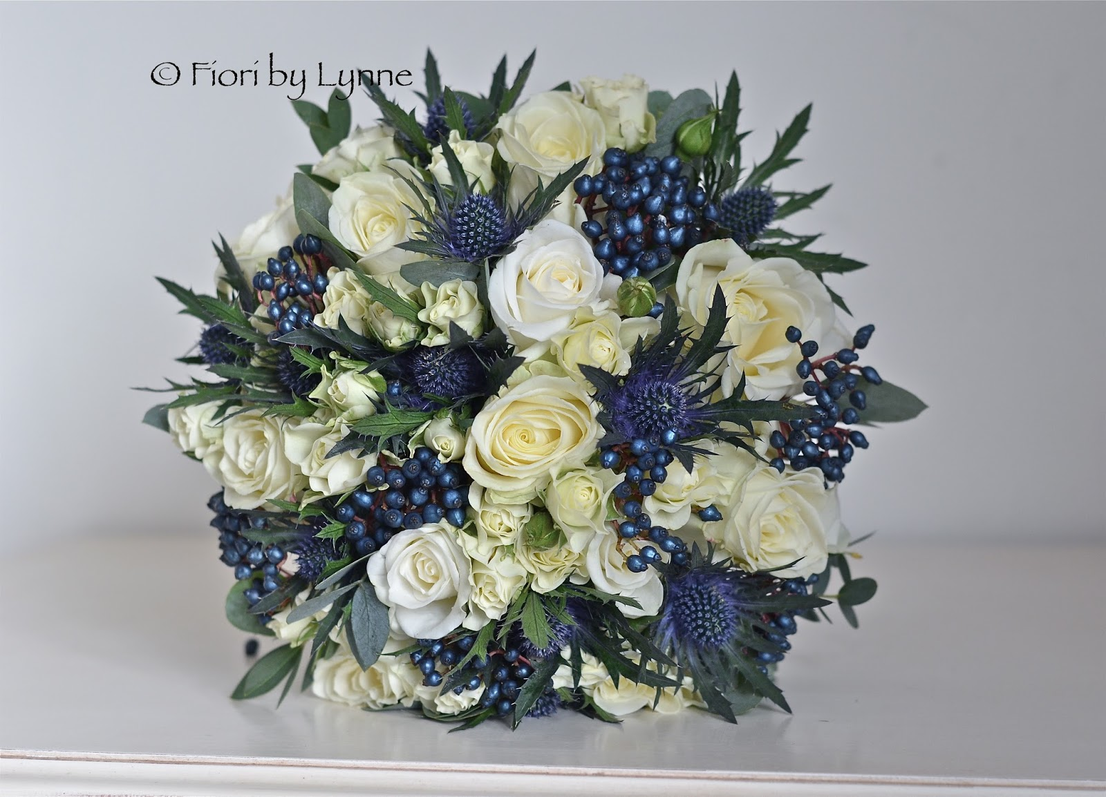 Wedding flowers blog ninas winter wedding flowers scottish ninas bouquet of rose thistle berry and eucalyptus in shades of ivory midnight and grey with eryngium representing the scottish thistle izmirmasajfo