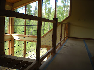 loft view windows, cable railing,  timbers http://huismanconcepts.com/
