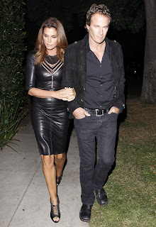 Cindy Crawford wearing a gorgeous black leather dress