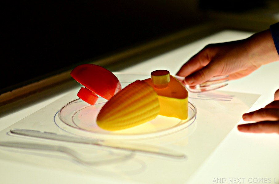 Play food on the light table from And Next Comes L