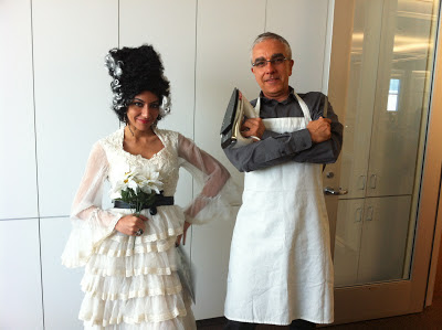 woman dressed in bride of frankenstein costume and man dressed in iron chef costume
