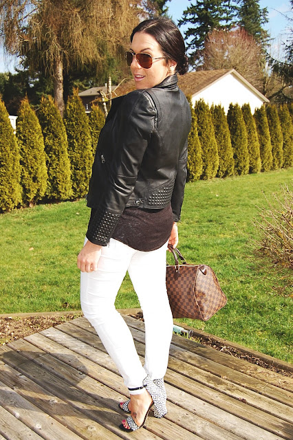 Studded leather Zara jacket, white jeans, geometric print sandals and a damier Louis Vuitton Speedy