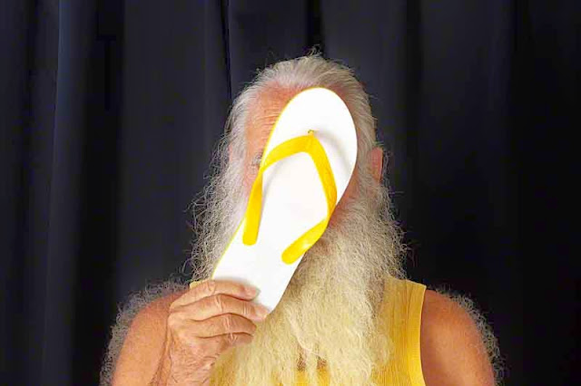 yellow flip-flop, yellow shirt, bearded dude