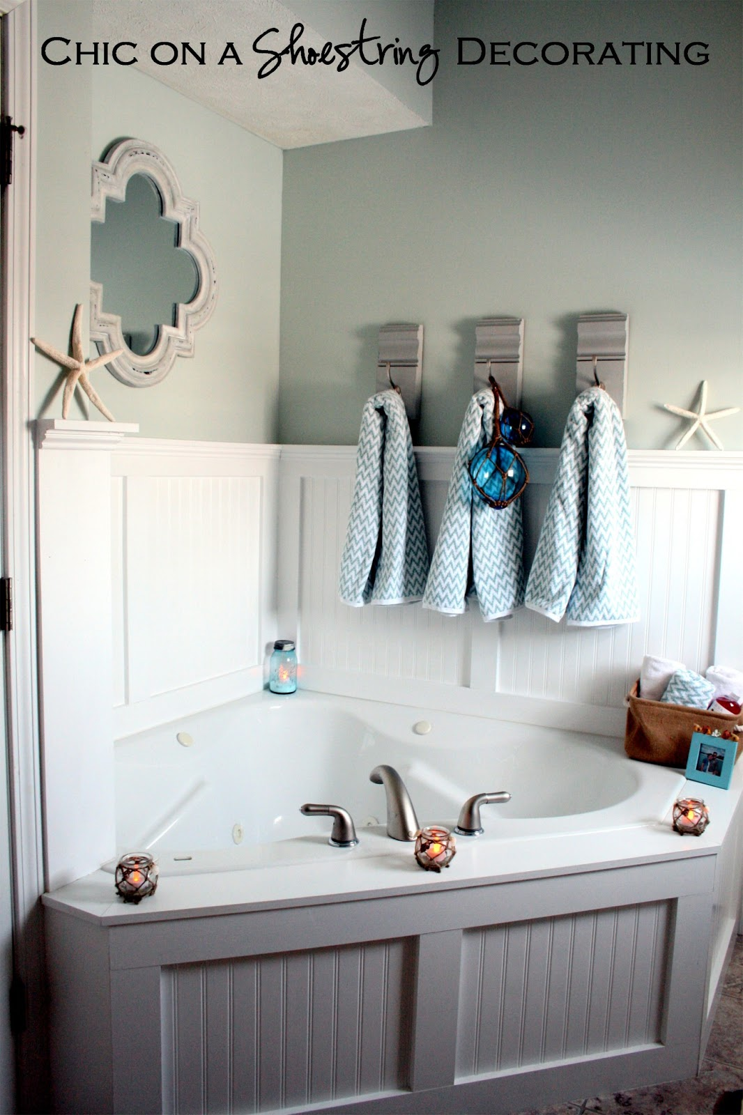 Chic on a shoestring decorating beachy bathroom reveal for Decorating ideas tub surround