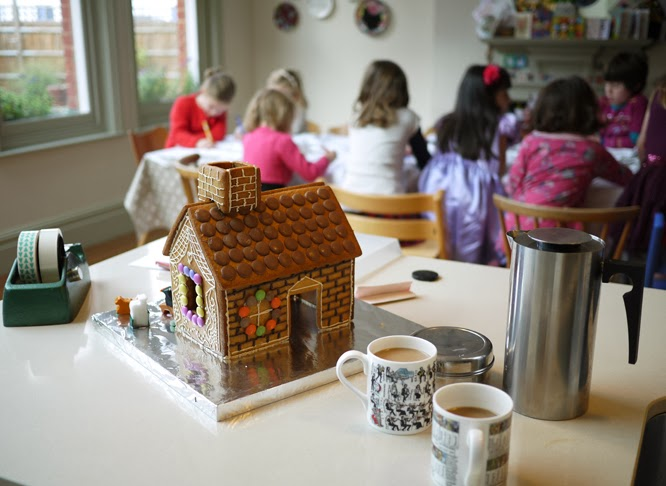 Coco's party underway with gingerbread house and coffee in foreground