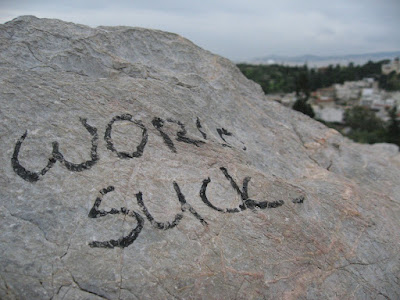 World sucks, a statement painted on a stone in Athens during the 2008 Greek riots