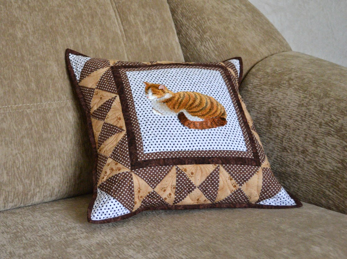 A cushion with an imbroidered cat