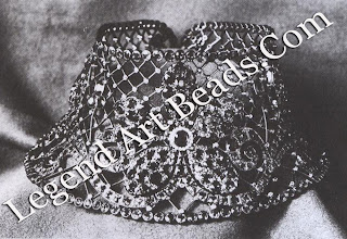 A flexible collar or neck ornament composed of 547 Montana sapphires and 299 diamonds, which wok 1,800 hours to produce. It, too, was exhibited in Paris in 1900.