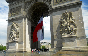 Fr. flag flying in the Arc de Trioumphe on the anniv. of D Day.