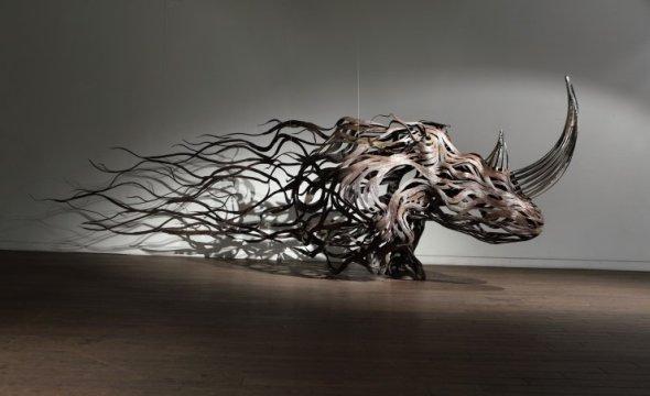 Kang Sung Hoon  esculturas de animais ao vento com tiras de metal Rinoceronte
