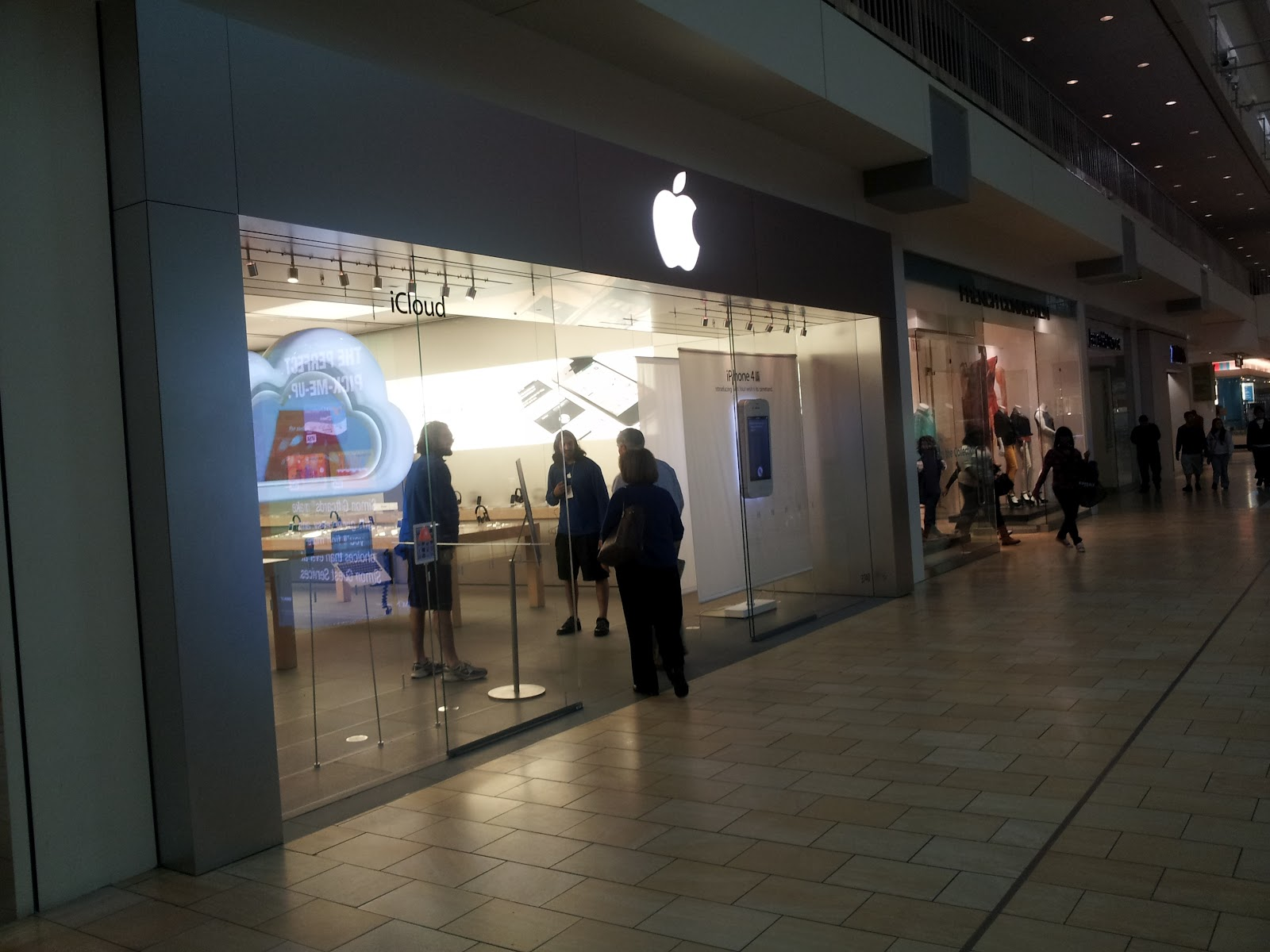Standing at the entrance of the Apple Store