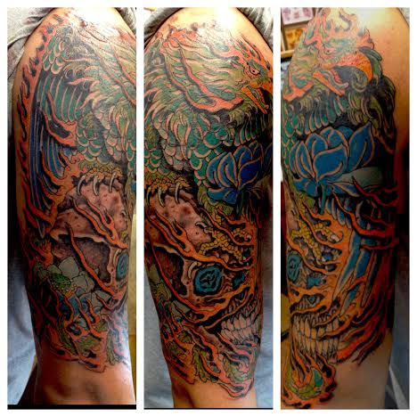 Phoenix with blue flower and skull by tattoo artist Jason Kunz for Triumph Tattoo
