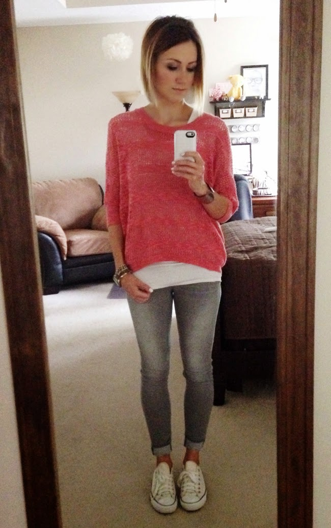 Coral top and gray jeans