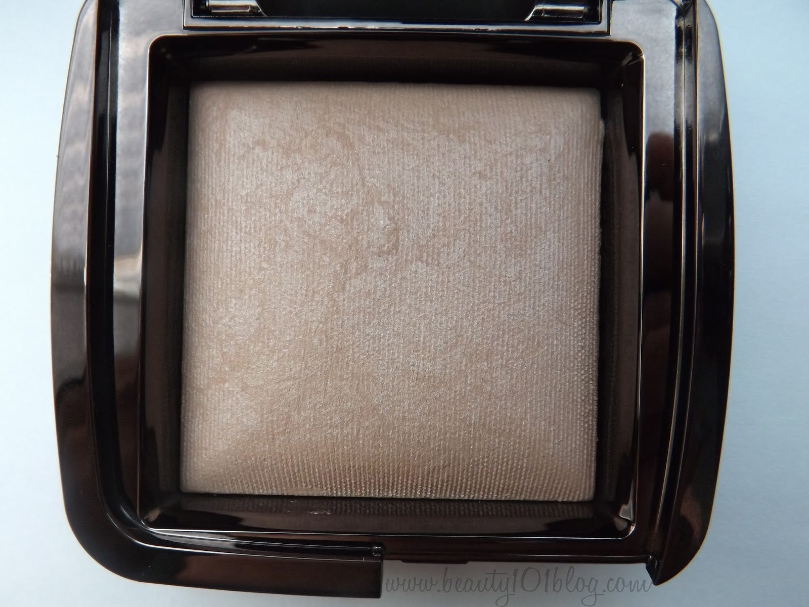 luminous light is described as a champagne pearl powder that creates a soft incandescent candlelight glow and i have to say this one is my favorite ambient lighting creates