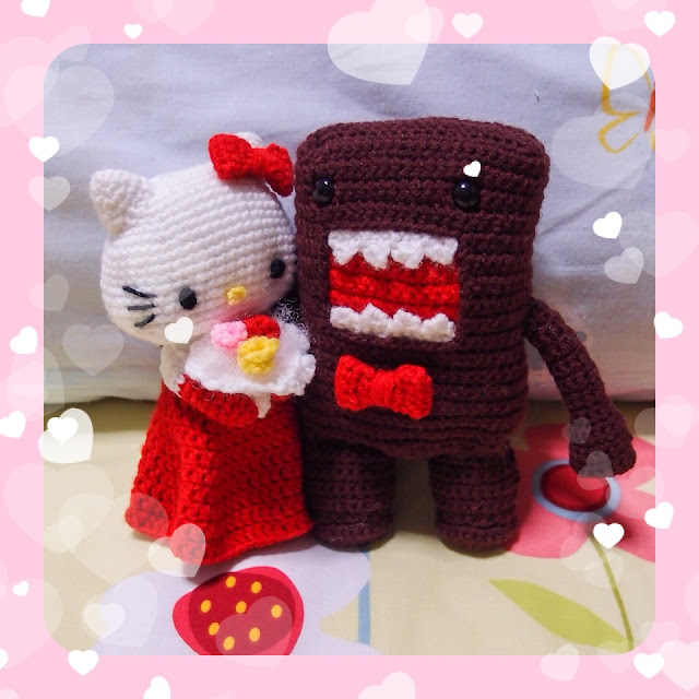 crocheted hello kitty bride and domo-kun groom amigurumi