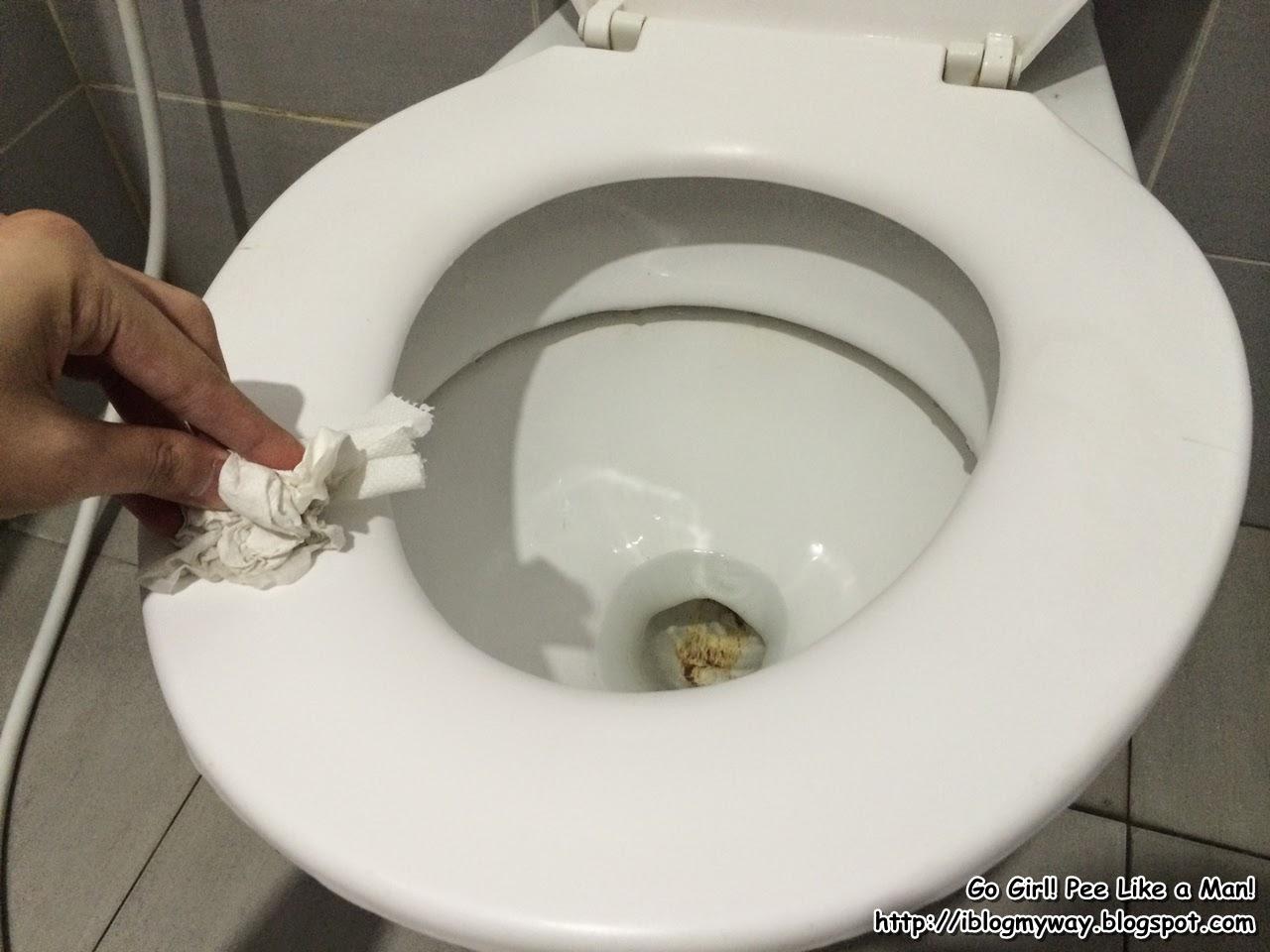 Man pee in toilet