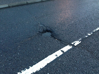 Pothole on Tom Johnston Road near Sainsburys supermarket