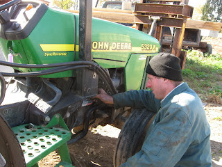 Dave inspecting tractor