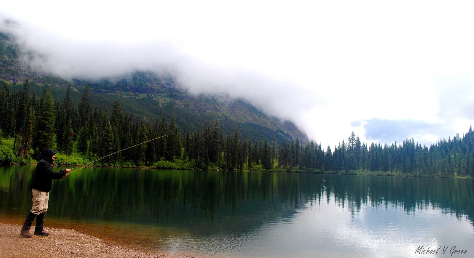 Writer in the wild backcountry fishing for Fishing in glacier national park