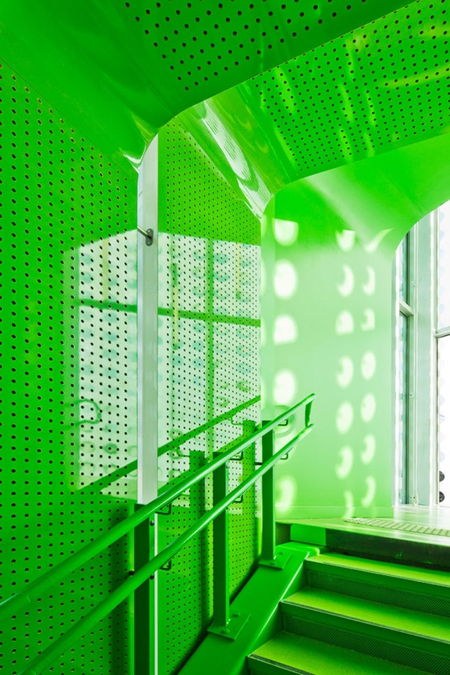 Close up photo of green painted staircase