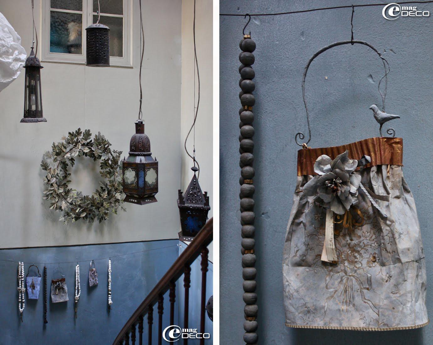 Suspendus à un fil de fer quelques colliers chapelet confectionnés à partir de cotillons et des sacs à rien en papier, créations Miss Clara