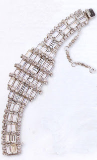 """A dazzling mid-I95os bracelet by Albert Weiss, signed """"Weiss"""". Each large baguette crystal is prong-set into rhodium-plated settings which articulate and flex like a chain."""