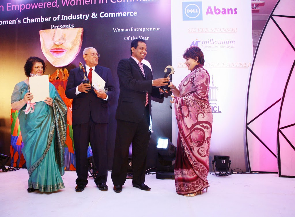 Chandhani Bandara receives the Large Scale Gold Award at the WCIC 2013 Awards.