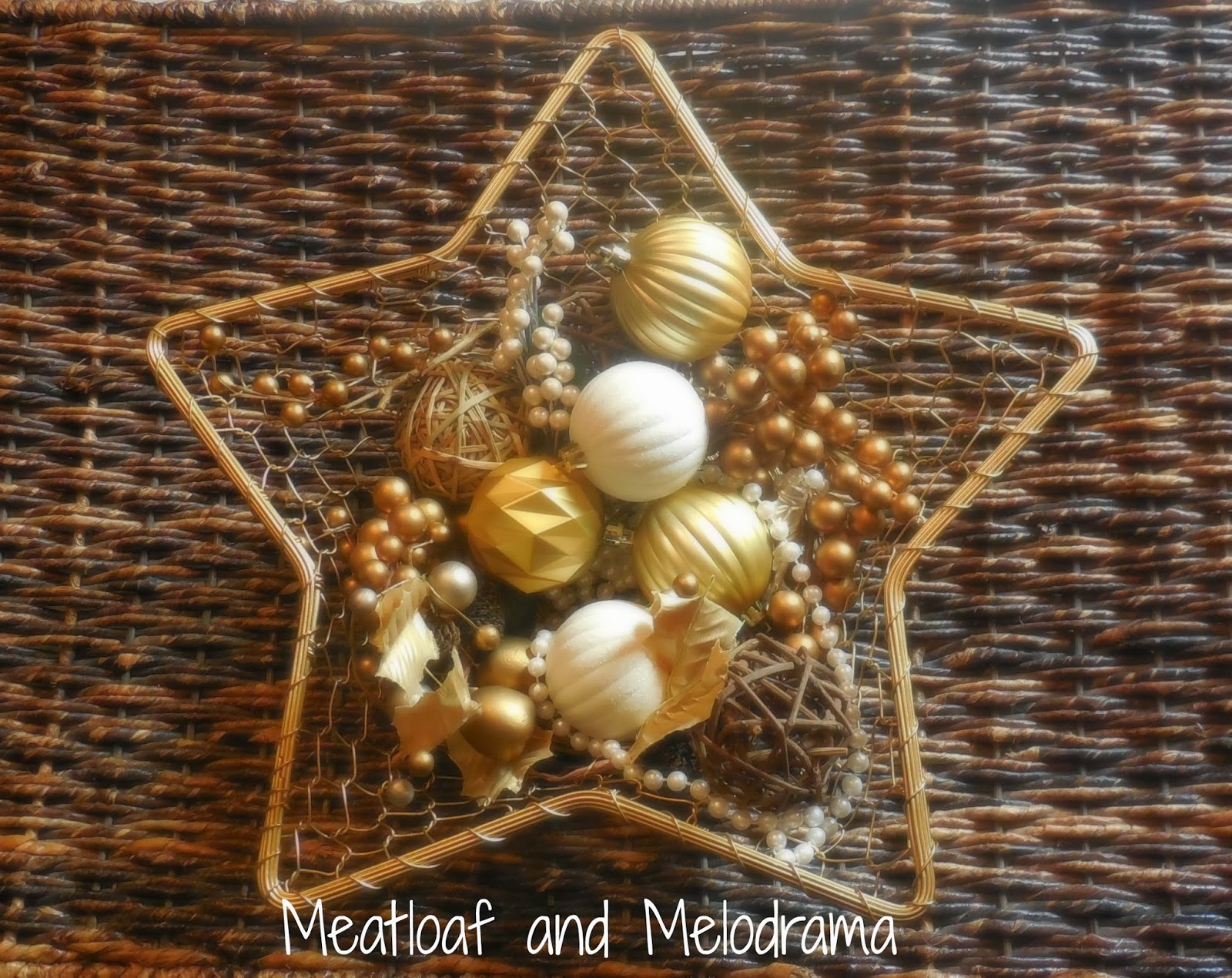 gold star basket with gold ornaments and vase filler
