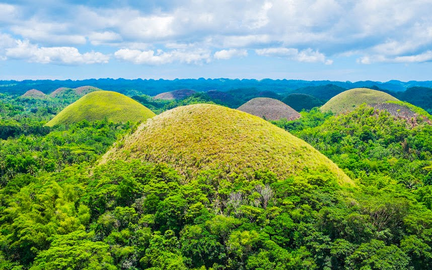 Chocolate Hills, Philippines Bohol Island's 1,200 or so Chocolate Hills are a bit like giant Maltesers melted across a huge tray – which makes this attraction a mouth-watering prospect for those legions among us with a weakness in that direction. Pleasantly unusual to behold rather than stunning, these unique mounds of limestone vary in height, up to nearly 400 feet. To savour the hills at their tastiest, go in the summer (January to May) when they've dried out to brown, writes Telegraph Travel's Steve Lunt. Philippines: an introductory guide