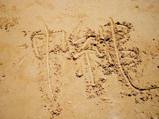 Kanji Okinawa in sand