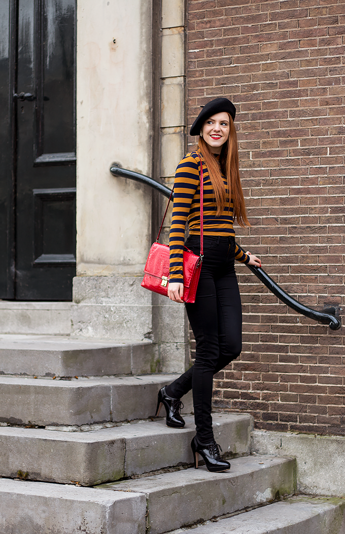 Retro fashion blogger outfit with yellow and blue striped turtle neck, beret and red bag